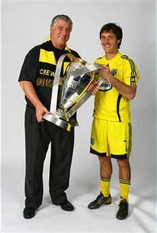 Sigi Schmid and Guillermo Barros Schelotto enjoy the Cup. (Getty Images)