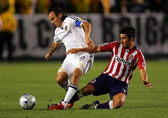 Landon Donovan and Paulo Nagamura battle in the third and last SuperClasico of the year. (Getty Images)