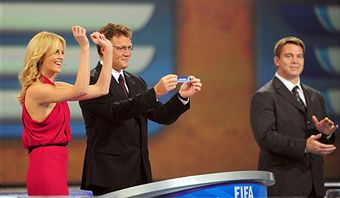 Charlize Theron reacts to South Africa being drawn into Group A. (Getty Images)