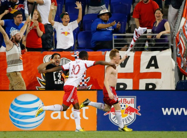 Dax McCarty and New York celebrated a wild win on Saturday night. (Jim O'Connor-USA TODAY Sports)