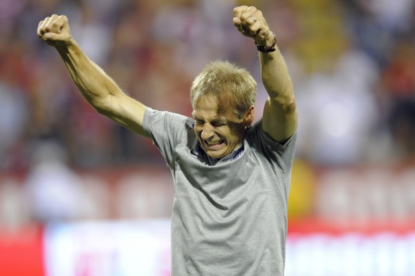 Jurgen Klinsmann has all the reason to celebrate after last night's World Cup clinching win. (David Richard-USA TODAY Sports)