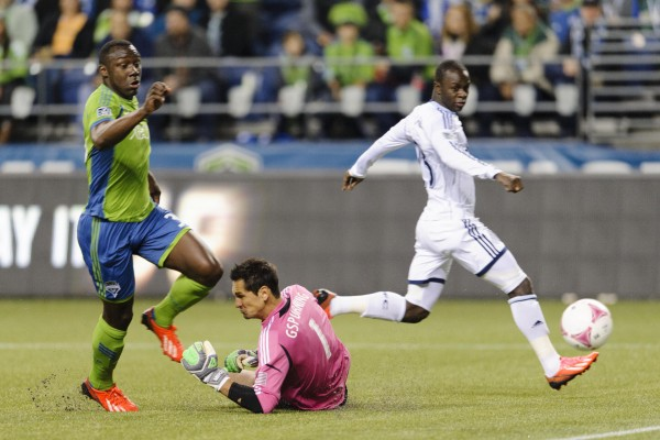 Ketuka Manneh (left) scored three goals on Wednesday in Seattle. (Steven Bisig-USA TODAY Sports)