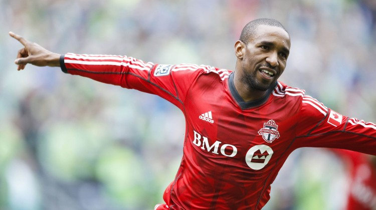 Toronto FC forward Jermain Defoe (18) celebrates his first goal against the Seattle Sounders FC during the first half at CenturyLink Field. Mandatory Credit: Joe Nicholson-USA TODAY Sports