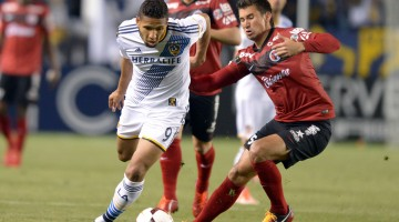 Los Angeles Galaxy forward Samuel (9) and Club Tijuana defender Elo Castro Guadarrama (54) battle for ball in Champions League match at StubHub Center. The Galaxy defeated Club Tijuana 1-0. Mandatory Credit: Kirby Lee-USA TODAY Sports