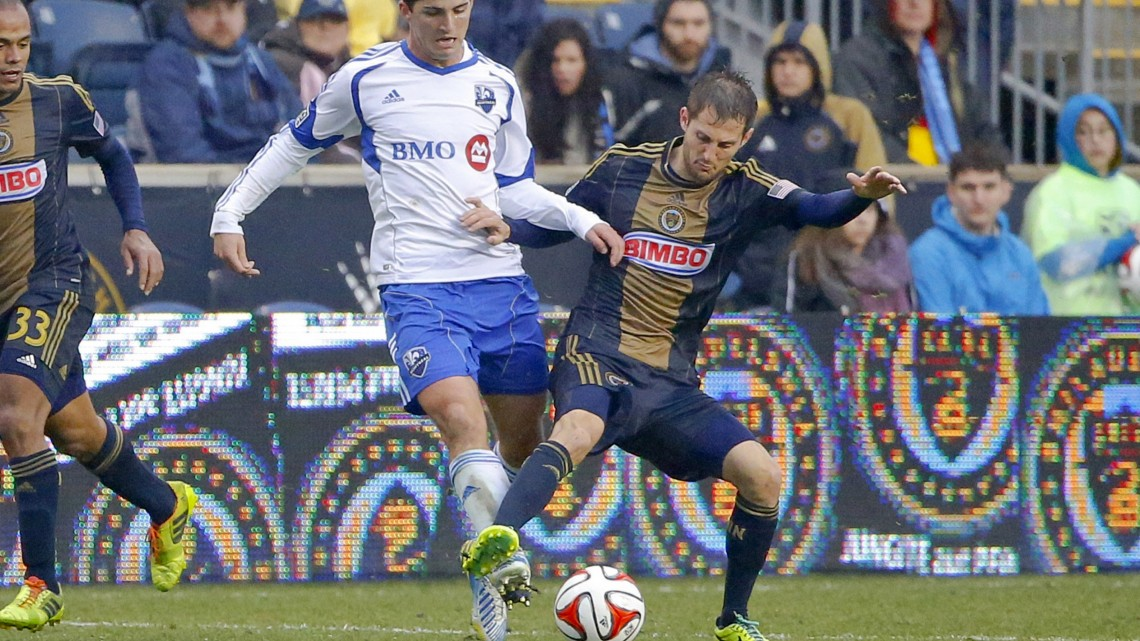 Montreal Impact defender Eric Miller (left) and Philadelphia Union midfielder Vincent Nogueira (right) compete for the ball during the second half at PPL Park. Game ended in 1-1 tie. Mandatory Credit: Jim O'Connor-USA TODAY Sports