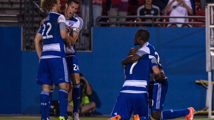 FC Dallas defender Matt Hedges (24) and forward Blas Perez (7) and defender Matt Hedges (24) celebrate Perez game winning goal against Toronto FC during the second half at Toyota Stadium. FC Dallas defeated Toronto FC 2-1. Mandatory Credit: Jerome Miron-USA TODAY Sports