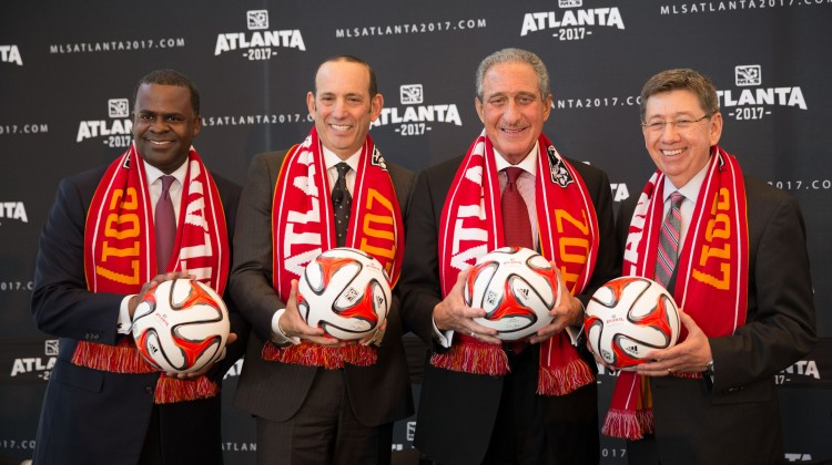 Atlanta mayor Kasim Reed (left), MLS commissioner Don Garber (second from left), team owner Arthur Blank (second from right), and Georgia World Congress Center executive director Frank Poe pose with soccer balls following the announcement of an MLS expansion team in Atlanta at Ventanas. Mandatory Credit: Kevin Liles-USA TODAY Sports